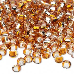 seed bead, glass, two-toned silver-lined amber/yellow, 3-4mm irregular round. sold per pkg of 25 grams.