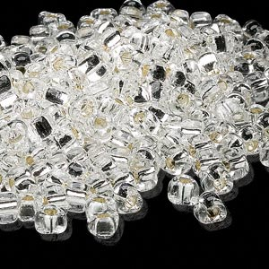 seed bead, miyuki, glass, silver-lined translucent clear, (tr1101), #5 triangle. sold per 250-gram pkg.