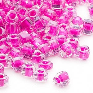 seed bead, miyuki, glass, transparent clear color-lined fuchsia, (tr1110), #5 triangle. sold per 250-gram pkg.