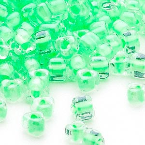seed bead, miyuki, glass, transparent clear color-lined light green, (tr1120), #5 triangle. sold per 250-gram pkg.