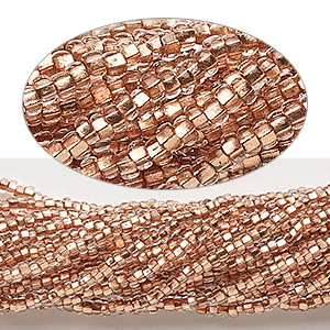 seed bead, preciosa, czech glass, copper-lined translucent clear, #11 round. sold per 1/2 kilogram pkg.