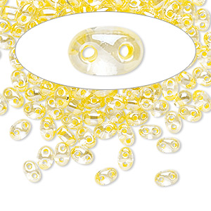 seed bead, preciosa twin™, czech glass, transparent yellow-lined clear terra, 5x2.5mm oval with 2 holes. sold per 50-gram pkg.
